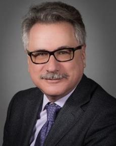 Dr. Elliot  Belenkov Hematologist  accepts Banker